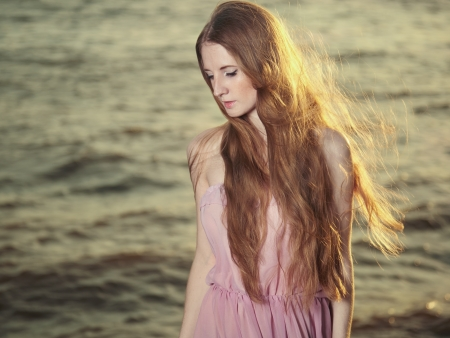 Beautiful redhead girl at pond  Beauty summertime photo
