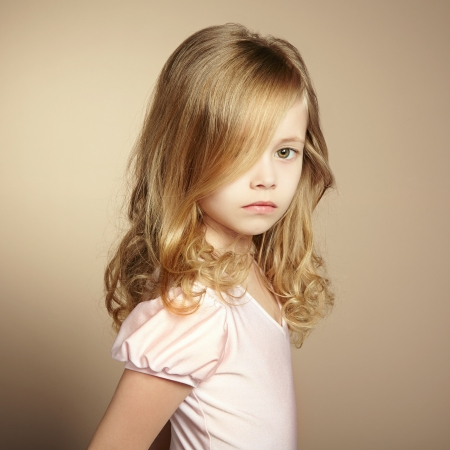 hair curl: Portrait of pretty little girl. Fashion photo Stock Photo