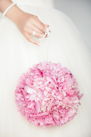 Wedding bouquet in hands of bride. Wedding photo photo