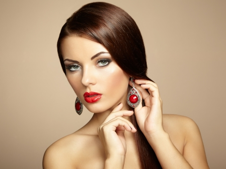 Portrait of beautiful brunette woman with earring. Perfect makeup. Fashion photo photo