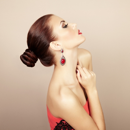Portrait of beautiful brunette woman with earring. Perfect makeup. Fashion photo Stock Photo - 21777743