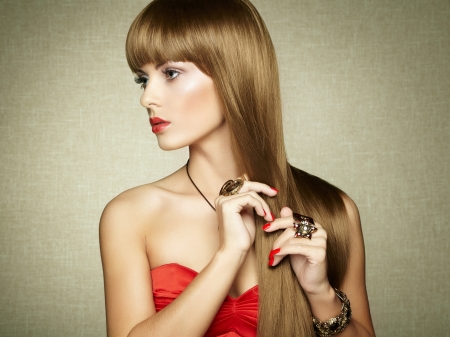 Portrait of young beautiful woman with jewelry. Beauty photo photo