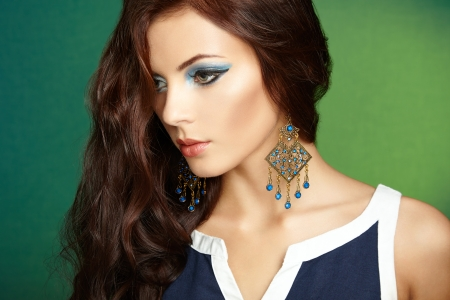 Portrait of beautiful brunette woman with earring. Perfect makeup. Fashion photo Stock Photo - 22553096