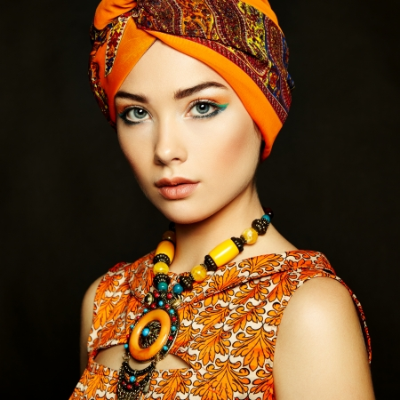 Portrait young beautiful woman with necklace. Fashion photo photo