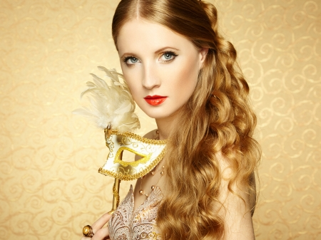 Beautiful young woman in mysterious golden Venetian mask. Fashion photo photo