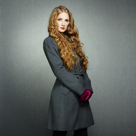 Portrait of young woman in autumn coat. Fashion photo photo