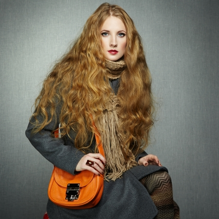 greatcoat: Portrait of young woman in autumn coat. Fashion photo