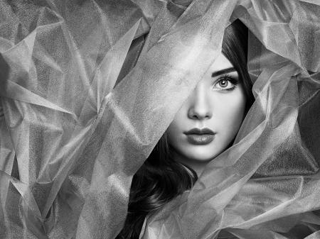 Fashion photo of beautiful women under blue veil photo