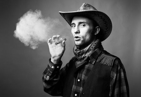 Portrait of man. The man smokes a cigar. Black and white photo Stock Photo