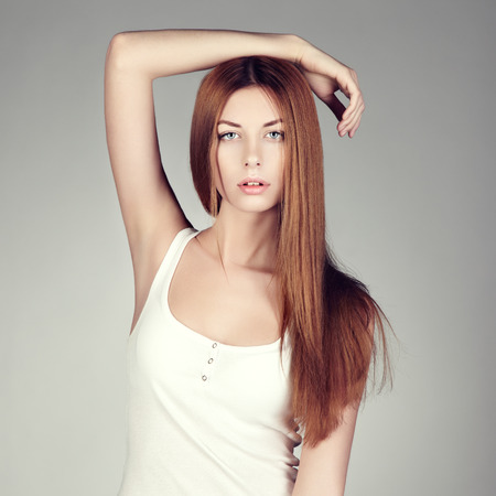 Fashion photo of a young woman with red hair. Close-up portrait photo