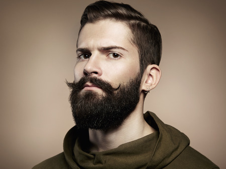 male fashion model: Portrait of handsome man with beard  Close-up
