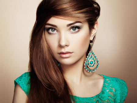forearms: Portrait of beautiful young woman with earring