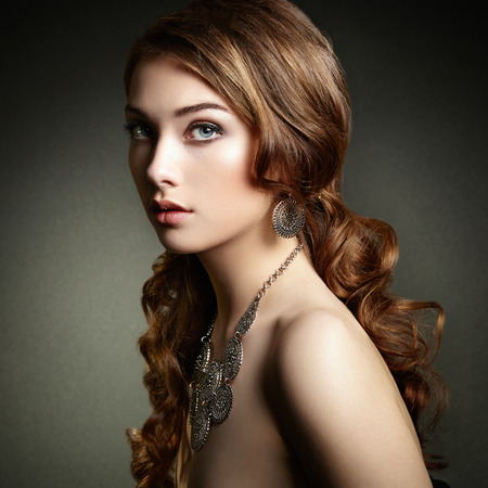 Beauty woman with long curly hair