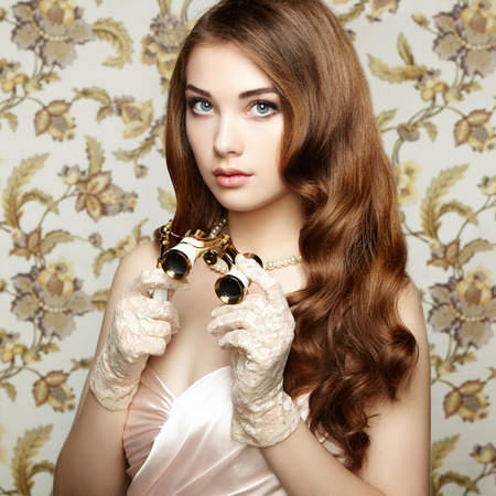 Portrait of young woman with binoculars  Fashion portrait  Retro photo