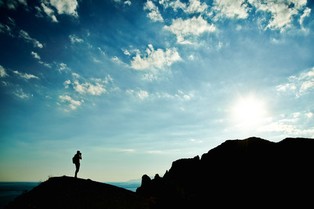 Man silhouette at sunset in mountains. Crimea landscape photo