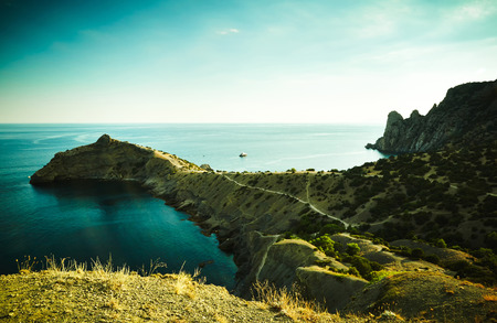 Mountains and sea at sunset. Crimea landscape. Nature background photo
