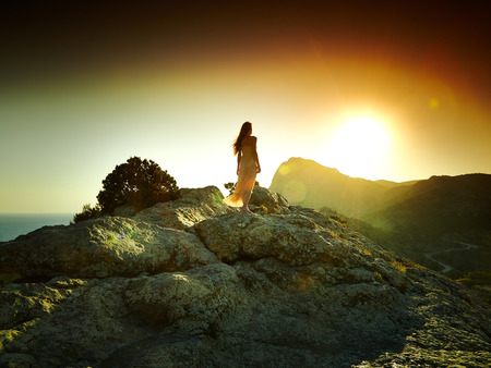 people   lifestyle: Woman silhouette at sunset in mountains. Crimea landscape