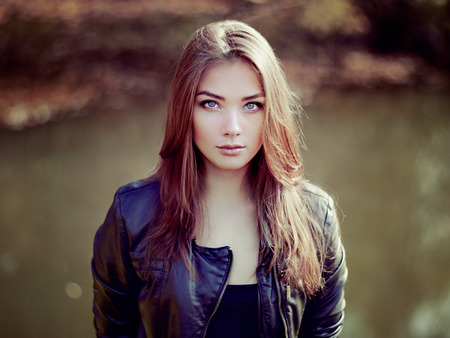 Portrait of young beautiful woman in leather jacket. Fashion photo Stok Fotoğraf