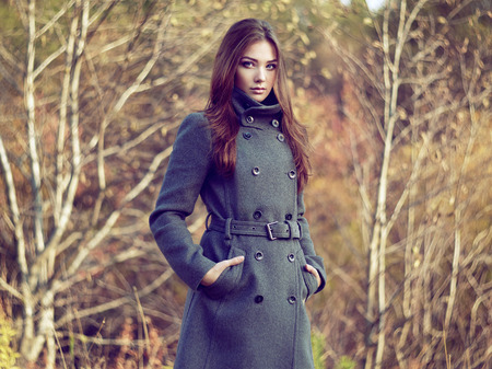 greatcoat: Portrait of young beautiful woman in autumn coat. Fashion photo