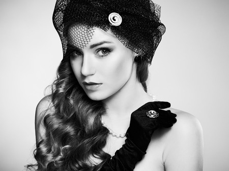 Retro portrait of  beautiful woman. Vintage style. Fashion photo. Black and white