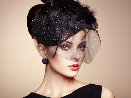 girl in a hat: Retro portrait of a beautiful woman. Vintage style. Perfect make-up. Fashion photo