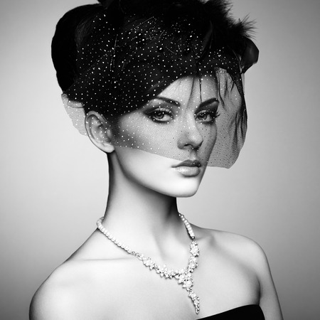 Retro portrait of a beautiful woman. Vintage style. Perfect make-up. Fashion photo. Black and white photo photo