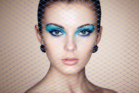 ladylike: Portrait of young beautiful woman close up. Perfect makeup. Perfect skin. Fashion photo