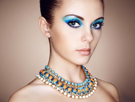 close up: Portrait of young beautiful woman close up. Perfect makeup. Perfect skin. Fashion photo