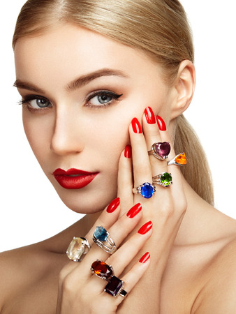 Portrait of beautiful woman with jewelry. Manicure and makeup. Perfect skin. Fashion beauty. Ring. Blonde girl. Close up photo