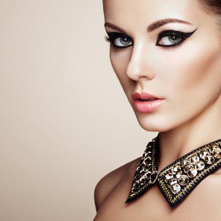 sensual nude: Portrait of beautiful sensual woman with elegant hairstyle. Diamond collar. Perfect makeup. Fashion photo
