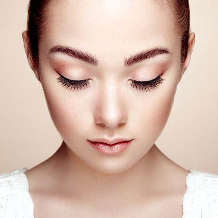 face: Beautiful woman face. Perfect makeup. Beauty fashion. Eyelashes. Cosmetic Eyeshadow