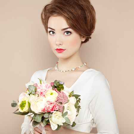 fairy woman: Woman with bouquet of flowers in her hands. Flowers. Spring. Bride. March 8. Fashion photo