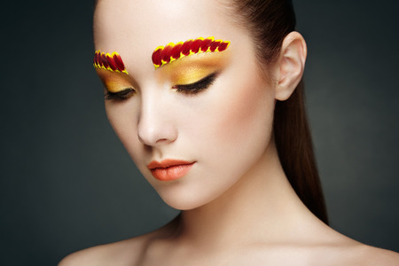 perfect face: Face of beautiful woman decorated with flowers. Perfect makeup. Beauty fashion. Eyelashes. Cosmetic Eyeshadow