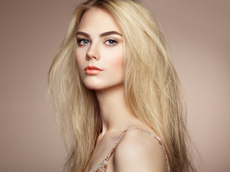 and magnificent: Fashion portrait of elegant woman with magnificent hair. Blonde girl. Perfect make-up. Hairstyle Stock Photo
