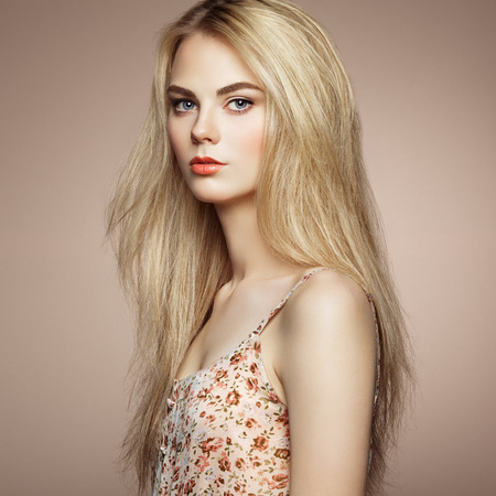 Fashion portrait of elegant woman with magnificent hair. Blonde girl. Perfect make-up. Hairstyle Archivio Fotografico