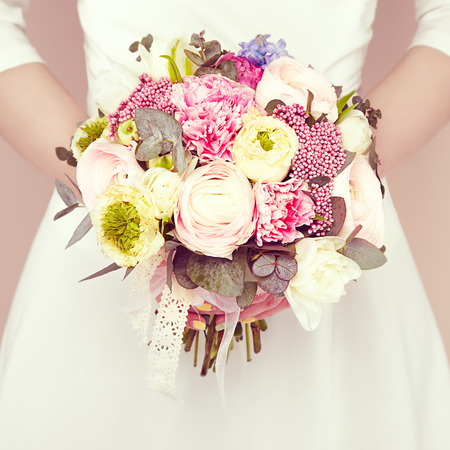 romantic flowers: Woman with bouquet of flowers in her hands. Flowers. Spring. Bride. March 8. Fashion photo