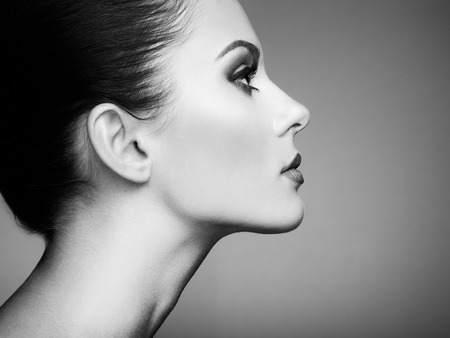 Beautiful woman face. Perfect makeup. Beauty fashion. Eyelashes. Cosmetic Eyeshadow. Black and white