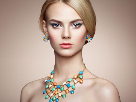 Portrait of beautiful sensual woman with elegant hairstyle.  Perfect makeup. Blonde girl. Fashion photo. Jewelry Stockfoto