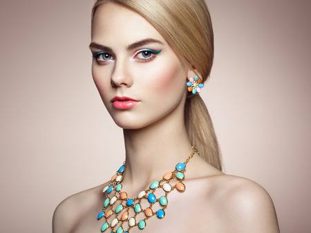 Portrait of beautiful sensual woman with elegant hairstyle.  Perfect makeup. Blonde girl. Fashion photo. Jewelry Standard-Bild