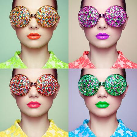 Portret van mooie jonge vrouw met een gekleurde bril. Schoonheid mode. Perfecte make-up. Kleurrijke decoratie. Juwelen Stockfoto