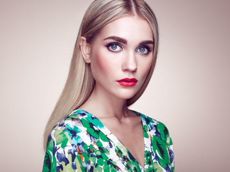 blonde woman: Fashion portrait of elegant woman with magnificent hair. Blonde girl. Perfect make-up. Hairstyle. Summer dress Stock Photo