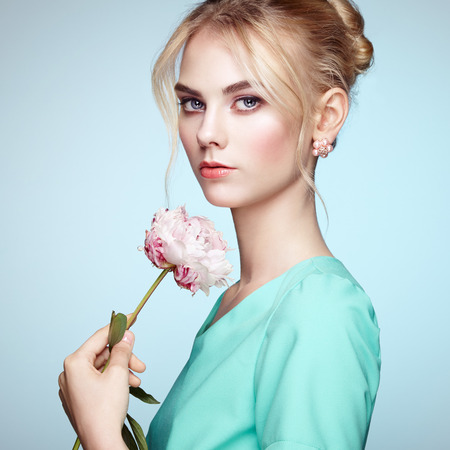 sensual: Portrait of beautiful sensual woman with elegant hairstyle.  Perfect makeup. Blonde girl. Fashion photo. Flowers