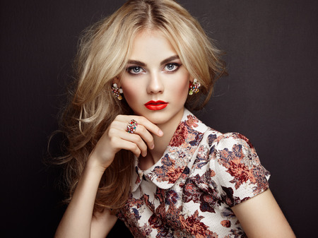 glamour woman elegant: Portrait of beautiful sensual woman with elegant hairstyle.  Perfect makeup. Blonde girl. Fashion photo. Jewelry and dress