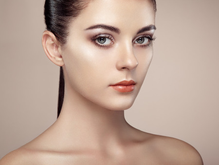 of cosmetics: Beautiful woman face. Perfect makeup. Beauty fashion. Eyelashes. Cosmetic Eyeshadow. Highlighting