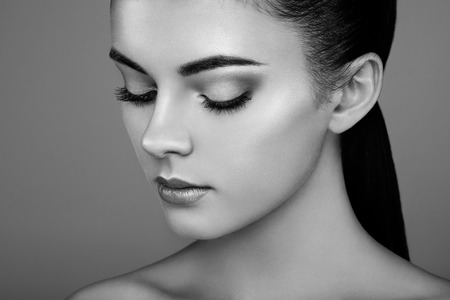 Beautiful woman face. Perfect makeup. Beauty fashion. Eyelashes. Cosmetic Eyeshadow. Highlighting. Black and white Stock Photo