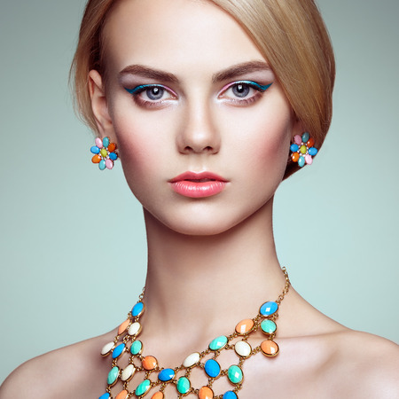 Portrait of beautiful sensual woman with elegant hairstyle.  Perfect makeup. Blonde girl. Fashion photo. Jewelry Imagens