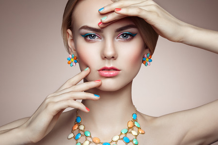 Portrait of beautiful sensual woman with elegant hairstyle.  Perfect makeup. Blonde girl. Fashion photo. Jewelry 스톡 콘텐츠
