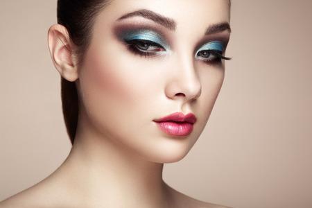 eyeshadow: Beautiful woman face. Perfect makeup. Beauty fashion. Eyelashes. Lips. Cosmetic Eyeshadow Stock Photo