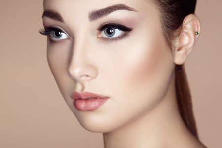 Beautiful woman face. Perfect makeup. Beauty fashion. Eyelashes. Lips. Cosmetic Eyeshadow Stock Photo
