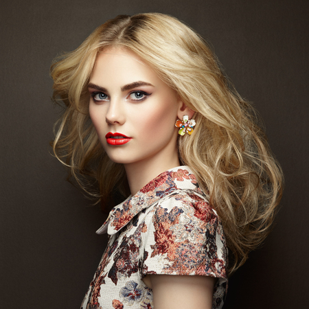 elegance: Portrait of beautiful sensual woman with elegant hairstyle.  Perfect makeup. Blonde girl. Fashion photo. Jewelry and dress